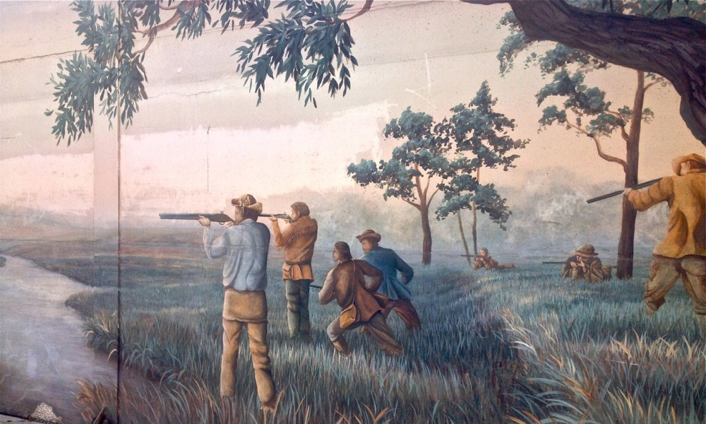 Metis people are holding guns during the Battle of Seven Oaks