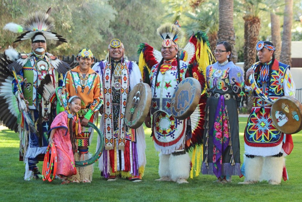 First Nations people wearing traditional clothes